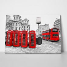 Red bus and telephone boxes 97675979 a