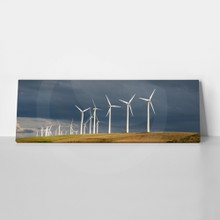 Wind turbines below a stormy sky in washington state