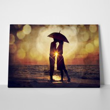 Couple kissing under umbrella 124886485 a