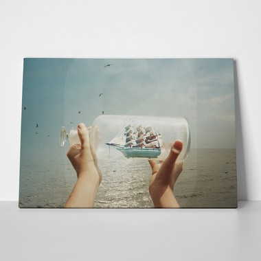 Child holding a ship in a bottle
