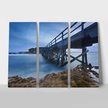 Australia sydney la perouse wooden boardwalk bridge to island underneath view towards vanishing point at sunset
