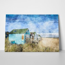 Handpainted colourful beach huts 261119462 a