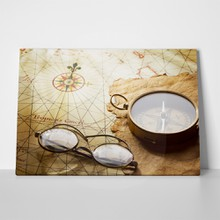 Compass and glasses on antique map 306901955 a