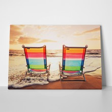 Beach chairs at sunset 98725346 a