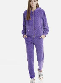 PURPLE VELOUR PANTS IN ALLOVER MOTIFS