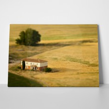 Country house on cereal field 104076932 a