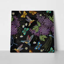 Blossoming lilacs and birds 695345368 a