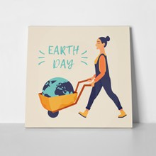 Woman with wheelbarrow and globe 1050975851 a