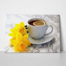 Lemon tea with daffodils 601458953 a