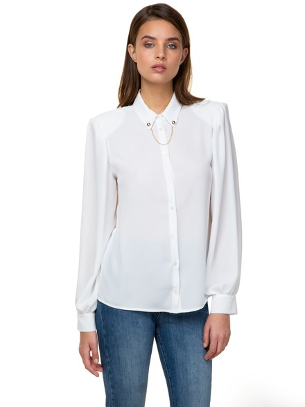 Shirt with shoulder pad