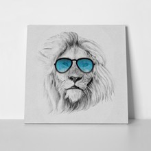 Lion with blue sunglasses 630987320 a