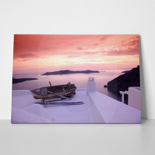 Santorini island old fishing boat on white roof 102034498 a