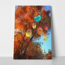 Colorful balloons on autumn forest